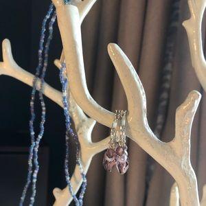 Silver hoop earrings with purple drop beads